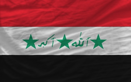 piktogramm: complete national flag of iraq covers whole frame, waved, crunched and very natural looking. It is perfect for background Stock Photo