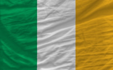 complete national flag of ireland covers whole frame, waved, crunched and very natural looking. It is perfect for background photo