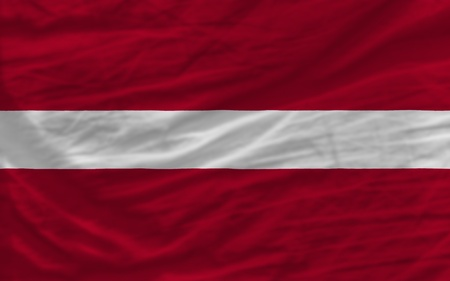 complete national flag of latvia covers whole frame, waved, crunched and very natural looking. It is perfect for background photo