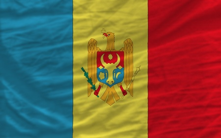 complete national flag of moldova covers whole frame, waved, crunched and very natural looking. It is perfect for background Stock Photo - 11939737