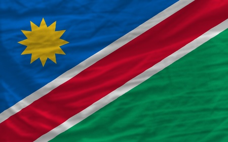 piktogramm: complete national flag of namibia covers whole frame, waved, crunched and very natural looking. It is perfect for background