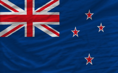 complete national flag of new zealand covers whole frame, waved, crunched and very natural looking. It is perfect for background photo