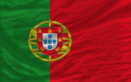 complete national flag of portugal covers whole frame, waved, crunched and very natural looking. It is perfect for background photo