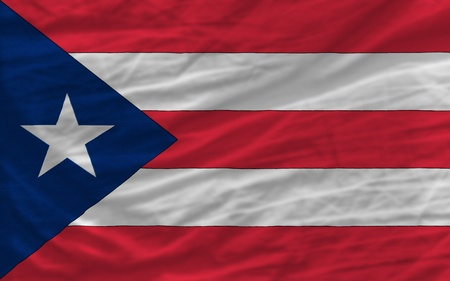 puerto: complete national flag of puertorico covers whole frame, waved, crunched and very natural looking. It is perfect for background
