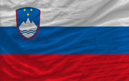 piktogramm: complete national flag of slovenia covers whole frame, waved, crunched and very natural looking. It is perfect for background Stock Photo