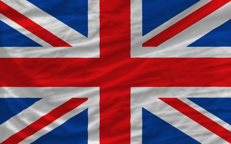 complete national flag of uk covers whole frame, waved, crunched and very natural looking. It is perfect for background photo