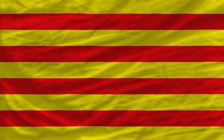 catalonian: complete national flag of  catalonia covers whole frame, waved, crunched and very natural looking. It is perfect for background