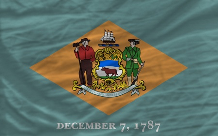 complete flag of us state of delaware covers whole frame, waved, crunched and very natural looking. It is perfect for background