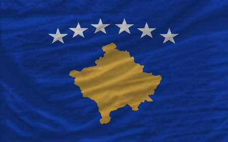 complete national flag of  kosovo covers whole frame, waved, crunched and very natural looking. It is perfect for background photo