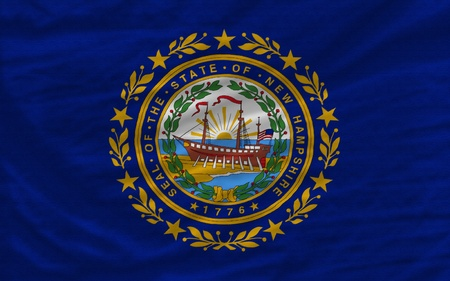 complete flag of us state of new hampshire covers whole frame, waved, crunched and very natural looking. It is perfect for background photo