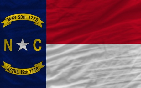 complete flag of us state of north carolina covers whole frame, waved, crunched and very natural looking. It is perfect for background photo