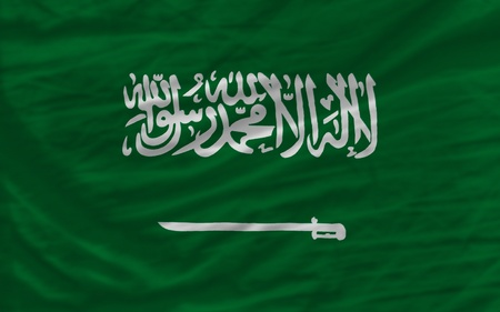 complete national flag of  saudi arabia covers whole frame, waved, crunched and very natural looking. It is perfect for background photo