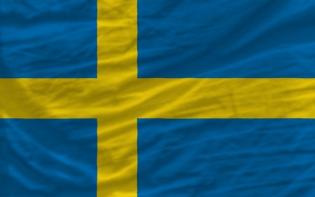 waved: complete national flag of sweden covers whole frame, waved, crunched and very natural looking. It is perfect for background Stock Photo