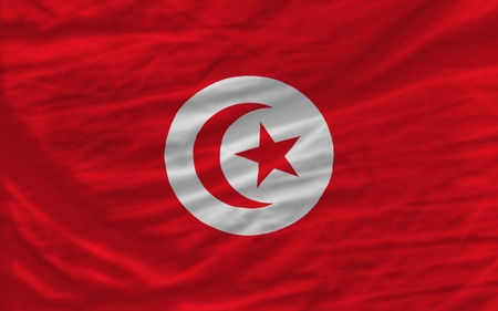 complete national flag of tunisia covers whole frame, waved, crunched and very natural looking. It is perfect for background Stock Photo - 11982934