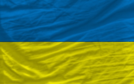 piktogramm: complete national flag of ukraine covers whole frame, waved, crunched and very natural looking. It is perfect for background