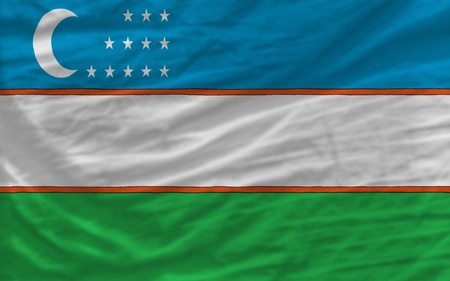 piktogramm: complete national flag of uzbekistan covers whole frame, waved, crunched and very natural looking. It is perfect for background Stock Photo