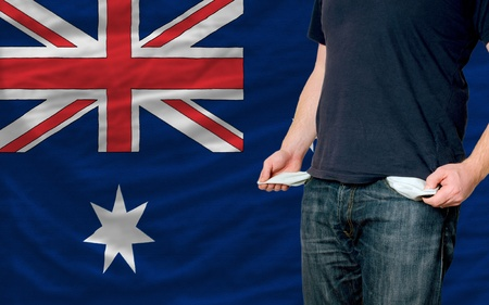 poor man showing empty pockets in front of australia flag photo