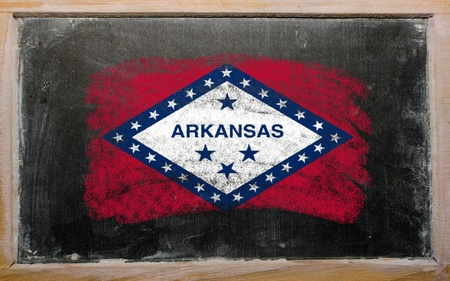 Chalky american state of arkansas flag painted with color chalk on old blackboard photo