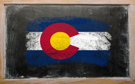 Chalky american state of colorado flag painted with color chalk on old blackboard