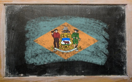 Chalky american state of delaware flag painted with color chalk on old blackboard photo