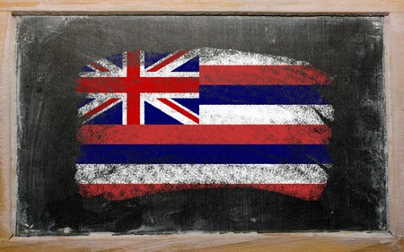 Chalky american state of hawaii flag painted with color chalk on old blackboard photo
