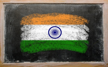 Chalky india flag painted with color chalk on old blackboard photo