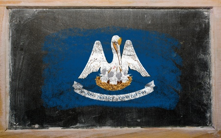 Chalky american state of louisiana flag painted with color chalk on old blackboard photo