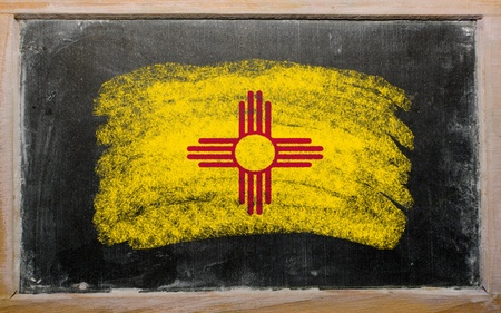 geography: Chalky american state of new mexico flag painted with color chalk on old blackboard