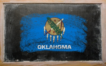 geography: Chalky american state of oklahoma flag painted with color chalk on old blackboard Stock Photo
