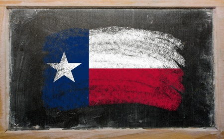 Chalky american state of texas flag painted with color chalk on old blackboard Stock Photo