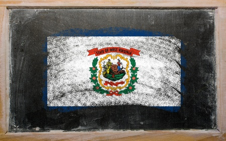 geography: Chalky american state of west virginia flag painted with color chalk on old blackboard