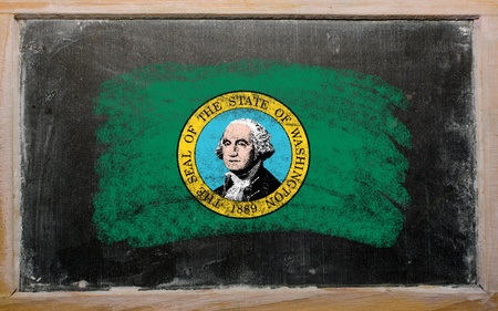 Chalky american state of washington flag painted with color chalk on old blackboard photo