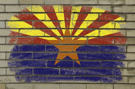Chalky and grunge american state of arizona flag painted with color chalk on brick wall photo