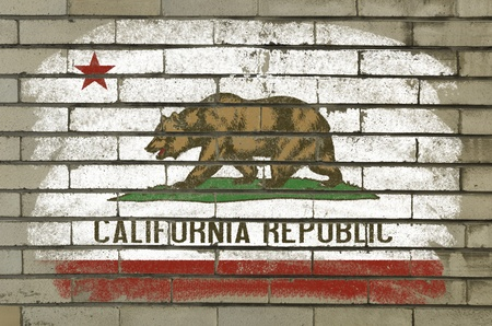 Chalky and grunge american state of california flag painted with color chalk on brick wall photo