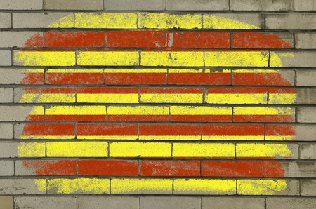 catalonian: Chalky and grunge catalonia flag painted with color chalk on brick wall
