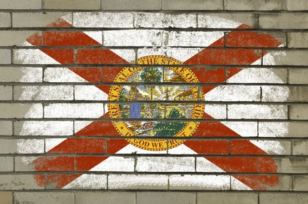 Chalky and grunge american state of florida flag painted with color chalk on brick wall photo