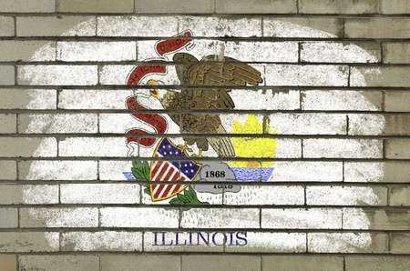 Chalky and grunge american state of illinois flag painted with color chalk on brick wall photo