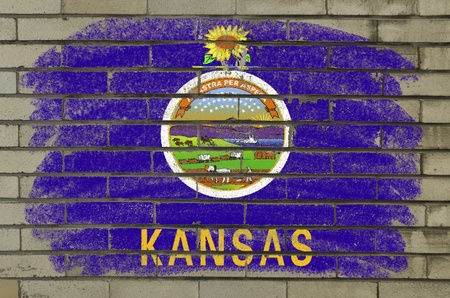 Chalky and grunge american state of kansas flag painted with color chalk on brick wall photo