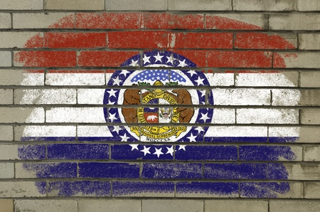 Chalky and grunge american state of missouri flag painted with color chalk on brick wall Stock Photo - 12172513