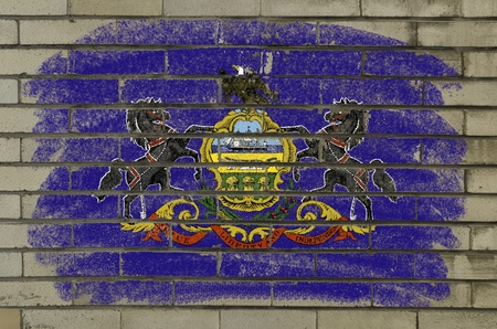 geography: Chalky and grunge american state of pennsylvania flag painted with color chalk on brick wall