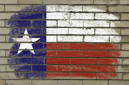 Chalky and grunge american state of texas flag painted with color chalk on brick wall photo