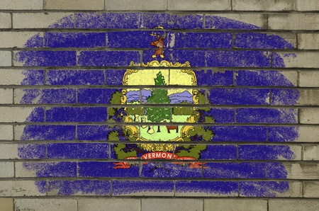 Chalky and grunge american state of vermont flag painted with color chalk on brick wall photo
