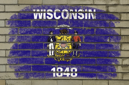 Chalky american state of wisconsin flag painted with color chalk on brick wall photo