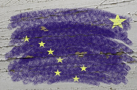 precisely: Chalky american state of alaska flag precisely painted with color chalk on grunge wooden texture Stock Photo
