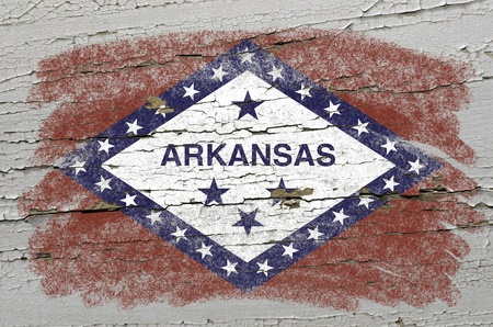 Chalky american state of arkansas flag precisely painted with color chalk on grunge wooden texture photo