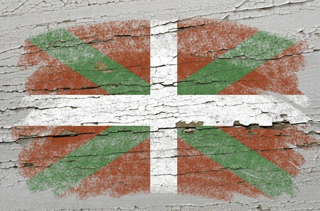 Chalky basque flag precisely painted with color chalk on grunge wooden texture