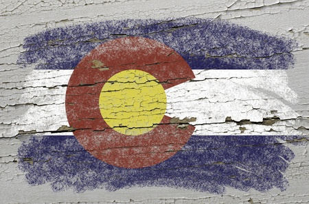 colorado flag: Chalky american state of colorado flag precisely painted with color chalk on grunge wooden texture