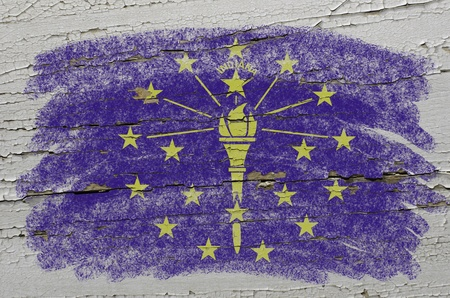 precisely: Chalky american state of indiana flag precisely painted with color chalk on grunge wooden texture