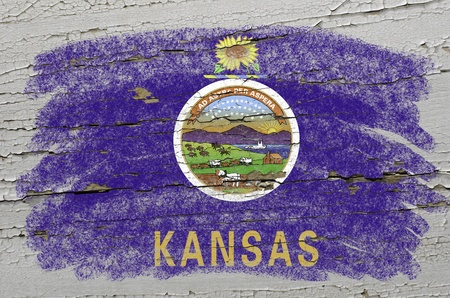 precisely: Chalky american state of kansas flag precisely painted with color chalk on grunge wooden texture