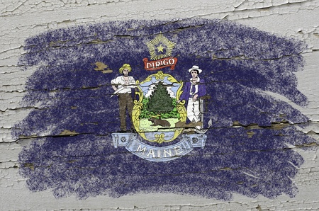 precisely: Chalky american state of maine flag precisely painted with color chalk on grunge wooden texture Stock Photo